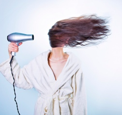 Woman-blow-drying-hair-cropped